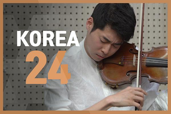 Violinist Danny Koo performing