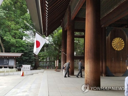 Aide to Japanese Prime Minister Visits Controversial War Shrine
