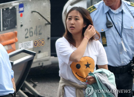 S.Korean Rasputin's daughter arrested on a flight to Seoul