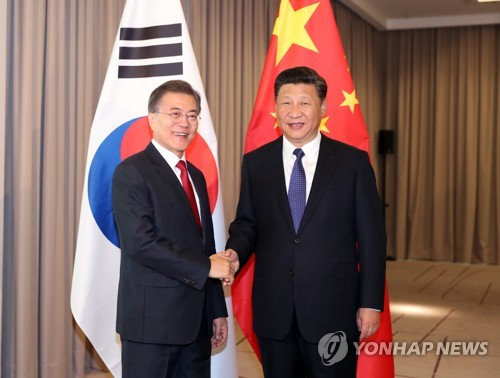 Xi, Moon united on peaceful solution to North Korean standoff