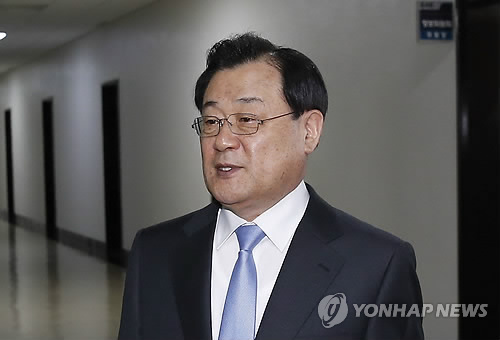 Ex-Spy Agency Chief Faces Questioning over Delivering Money to Presidential Office