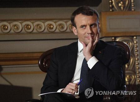 Moon invite Macron à se rendre en Corée du Sud pour les JO d'hiver de PyeongChang