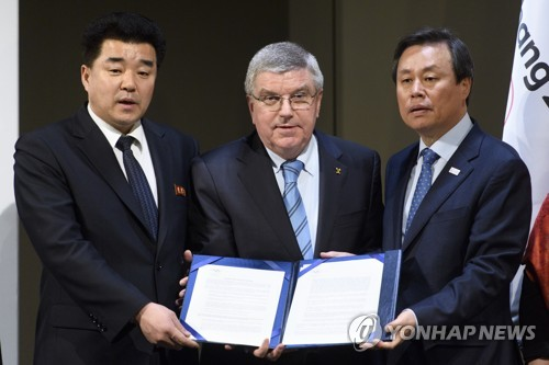 IOC: Two Koreas to march together at Winter Olympics opening ceremony