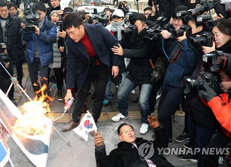 N. Korea Demands Apology over Flag Burning