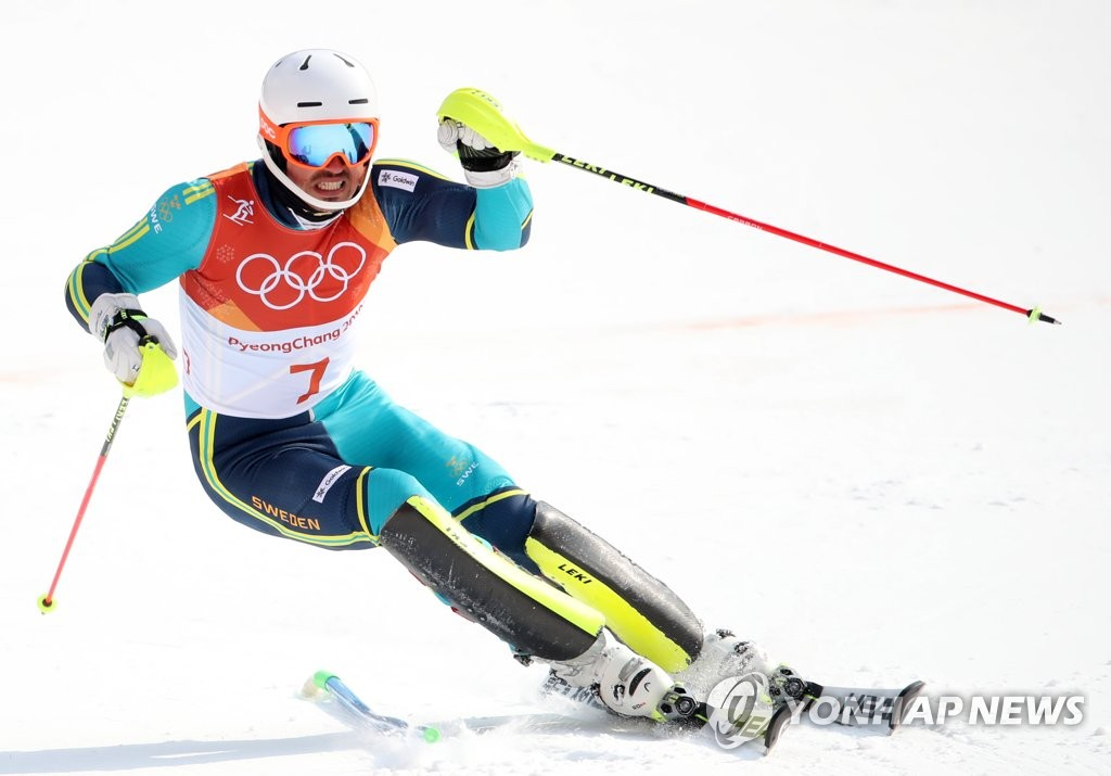 Myhrer wins Olympic slalom at 35 as favorites ski out