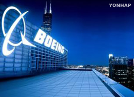 Lowers Position in Boeing (NYSE:BA)