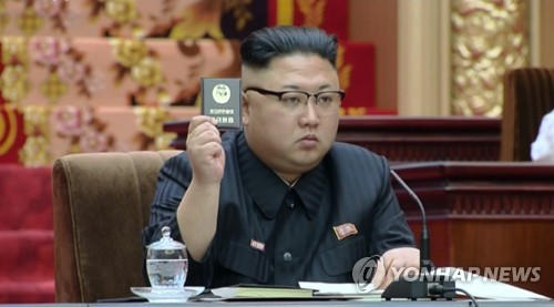North Korea's rubber stamp parliament convenes in leader's absence