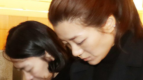 Sister of Korean Air 'nut rage' heiress suspended after angry outburst