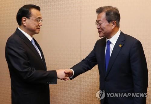 China, Japón y Corea del Sur acuerdan trabajar para desarme de Norcorea
