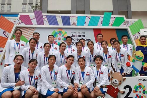 亚运南北韩代表团身着统一团服同日举行入村仪式
