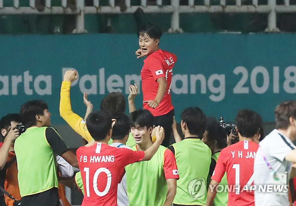 韩国队在2018亚运会男子足球与棒球赛上荣获冠军