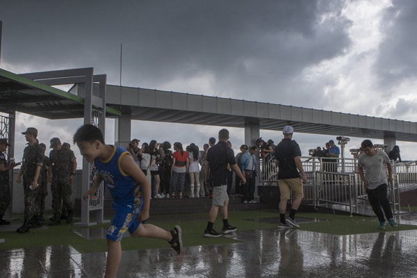 Cloudy Skies, Brief Showers Forecast for Sunday