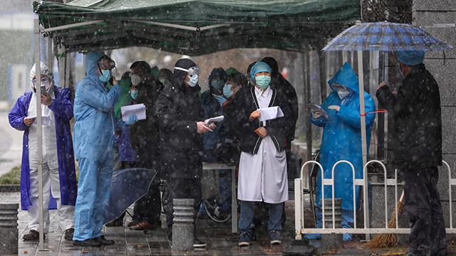 China's Virus Death Toll Tops 1,600