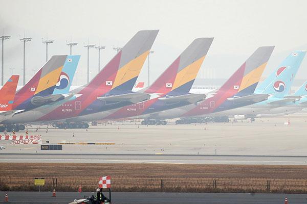 Korean Air mua lại Asiana Airlines
