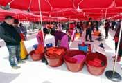 Vendors Unfold Parasol