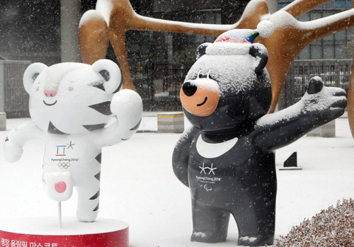 Olympic Mascots Enjoy First Snow