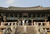 La llama olímpica llega al afamado templo