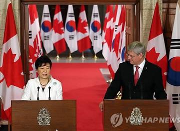 Firma del TLC entre Corea del Sur y Canadá