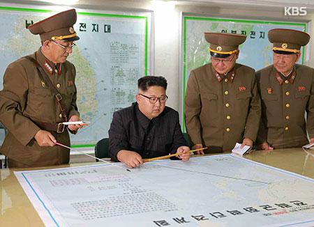 金正恩听取包围射击关岛有关报告 称将注视美国的姿态