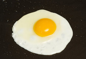Fry an egg slightly so that it's half-cooked and the shape is retained.