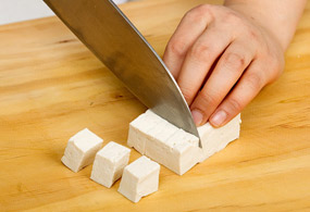 Dice the tofu into 1.5-by-1.5-cm cubes.