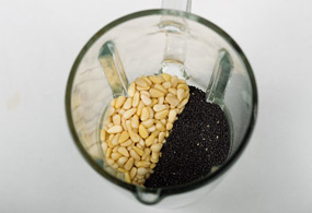 Grind pine nuts and black sesame finely with a small amount of water in the blender.